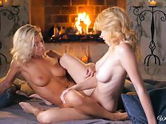 Niki lee young and penelope lynn warm up by the fire