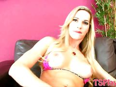 Enhanced tits blonde shemale jerks off her dick on sofa