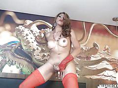 Tranny is packing some serious dick between her legs