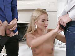 Blonde slut playing with two dicks