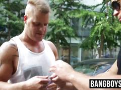 Hunks measure their strenght with an arm wrestling contest