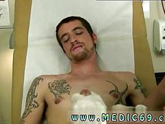 Skinny twink gets his dick jerked off by a doctor