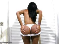 Juicy tranny with big lips shows massive ass in white thongs