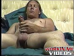 Stud freddyz with long hair strokes his fat meat on a bed