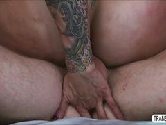 Tattoo tranny banging a white guys hot ass