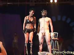 Extreme fetish fucking on public stage