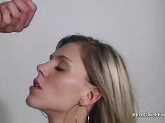 Selina runs her lips on cock tip