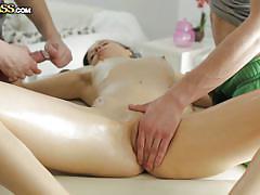 Sensual brunette fucked on massage table