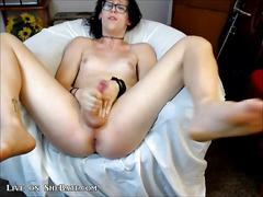 Young tranny with small tits strokes her dick