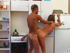 Sweet euro teen gets fucked standing against the fridge