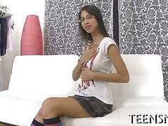 Busty teen schoolgirl with long legs licked on her couch