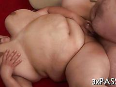 Redhead fatso gets her greasy shaved pussy fucked
