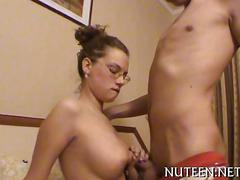Busty nerd girl sucking off dick in bed