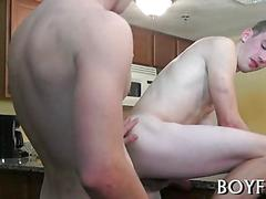 Two slim guys ass fucking each other in a kitchen