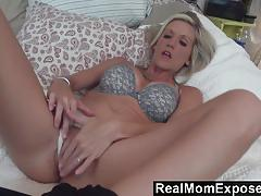 Blonde milf toys her pussy