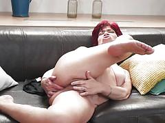 Short haired redhead lady fucking herself on the couch