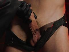 Dominating gay guy is latex roughing up his minion