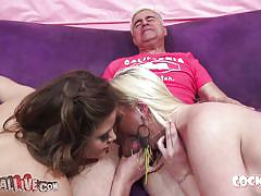 Blonde and brunette sluts sucks a horny guy dick