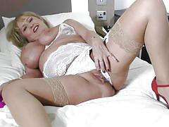 Mature bbw in white stockings fucking herself with a toy