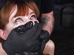 Rope tied redhead getting choked on a toy bbc