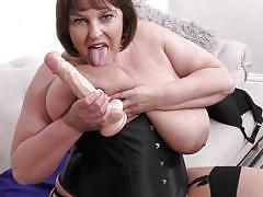Brunette lady in corset showing off her massive titties