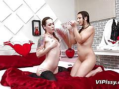 Two brunette lesbians' piss drinking competition