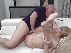 Horny mature couple having sex on couch
