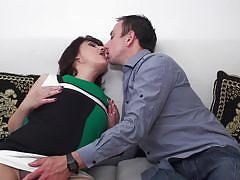 Mature woman sucking on a hard cock