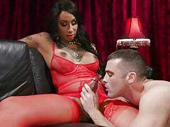 Busty tranny gives her lover a footjob