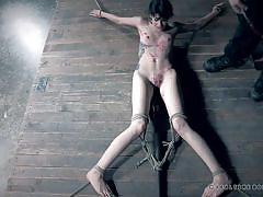 Tied-up slave enjoying hot wax torture
