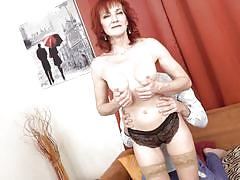 Redhead mature lets her horny lover stick his tongue deep into her wet pussy