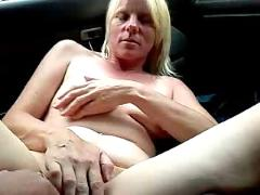 Blonde playing in car