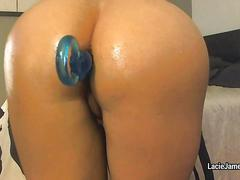 Oiled ass takes anal beads