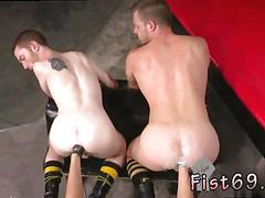 Two handsome gay dudes get fisted by a super horny hunk