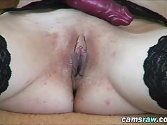 Trashy blonde slut in black stockings sodomizes pussy with fingers and dildo