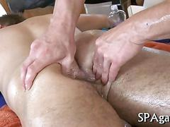 Horny masseur fucks his pretty muscled client in his asshole