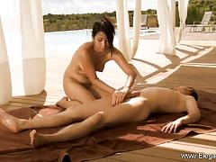 Masseuse massages this hard cock