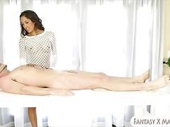 Pretty masseuse sucks and facialed under the massage table