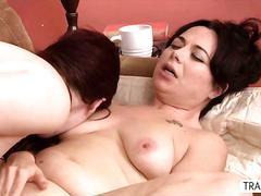 Redhead tranny fucks a good looking chick on the couch