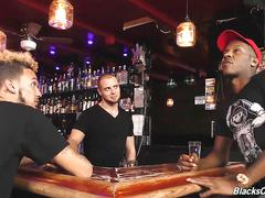 Black guys sharing the bartender at a pub