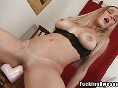 Slutty blonde rides dildo bouncing her big tits