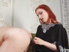 Redhead girlfriend poking her boyfriend with a pleasure