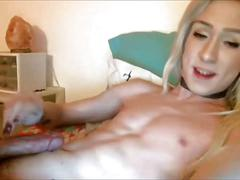 Fit blonde transsexual masturbates.