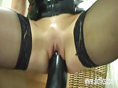 Mature blonde takes on huge toy