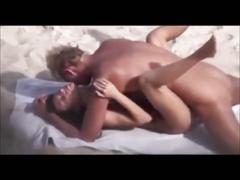 Blond guy fucks brunette on beach