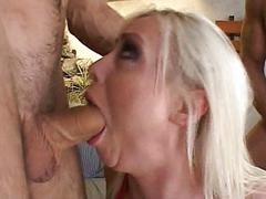 Tattooed blonde gives deep throat in 3some