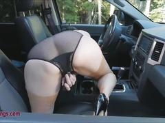 Mature lady masturbating at the side of the highway