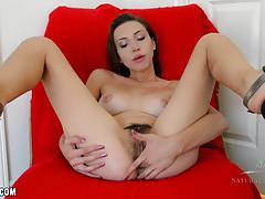 Hottie amber faye rubs her hairy pussy