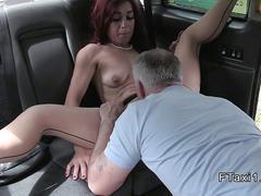 Redhead masturbates solo in fake taxi