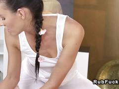 Lesbians tribbing in massage room